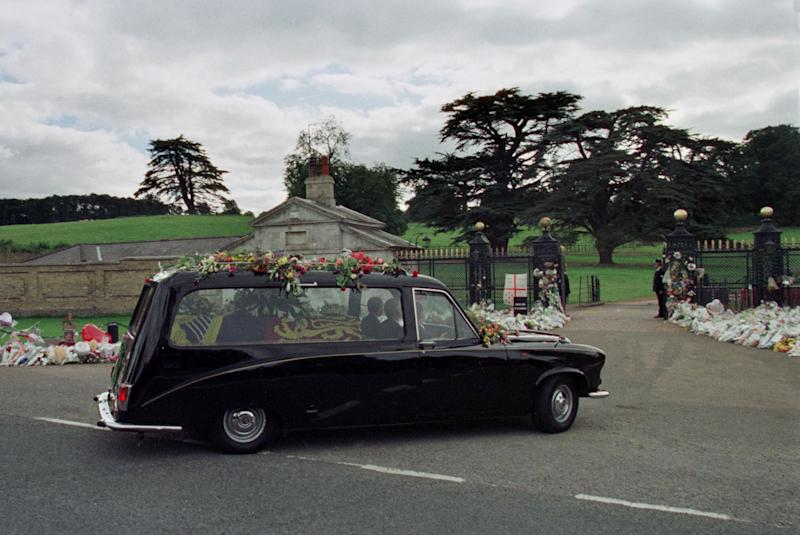 The hearse with the body of Diana, Princess of Wales arrives at Althorp House in Northamptonshire September 6. [Diana, who died in a car accident in Paris along with her friend Dodi Al Fayed, was buried today at the family home at the age of 36, following a funeral at Westminster Abbey].