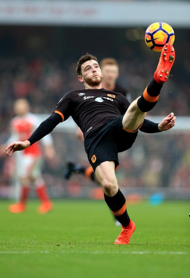 <p>Hull's Andrew Robertson clears the danger</p>