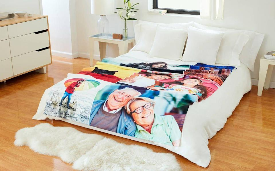"""<p>collage.com</p><p><strong>$54.99</strong></p><p><a href=""""https://www.collage.com/photo-blankets"""" rel=""""nofollow noopener"""" target=""""_blank"""" data-ylk=""""slk:Shop Now"""" class=""""link rapid-noclick-resp"""">Shop Now</a></p><p>Get Dad what he really wants for Father's Day: a 50 x 60 inch photo of your face.</p>"""