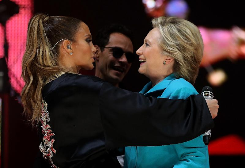 Democratic presidential nominee former Secretary of State Hillary Clinton embraces singer Jennifer Lopez during 'Get Out the Vote' concert in Miami, Florida, on October 29, 2016 (AFP Photo/Justin Sullivan)