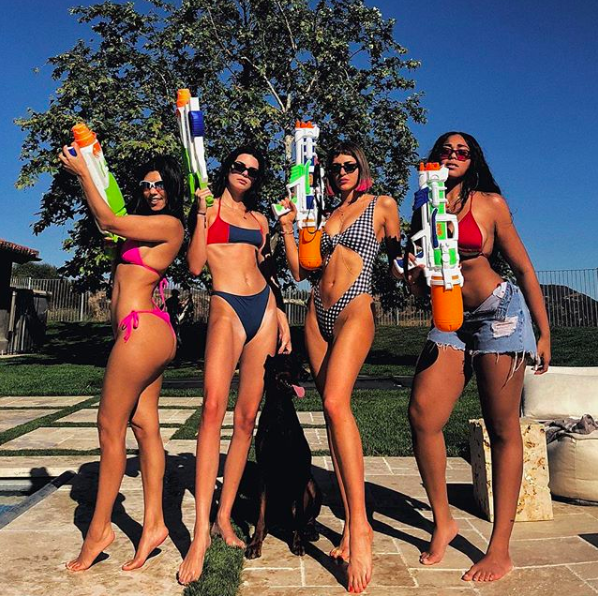 """<p>The Kardashian clan sure know how to throw a summer party. Look no further for major swimwear inspo this season from colour-block two-piece bikinis to cut-out swimsuits (water guns not included). FYI, Kendall Jenner's look is by Solid and Striped and it's still up for <a rel=""""nofollow"""" href=""""https://www.solidandstriped.eu/collections/best-sellers/products/the-jessica-red-slate?variant=621551288336"""">grabs</a>. <em>[Photo: Instagram]</em> </p>"""