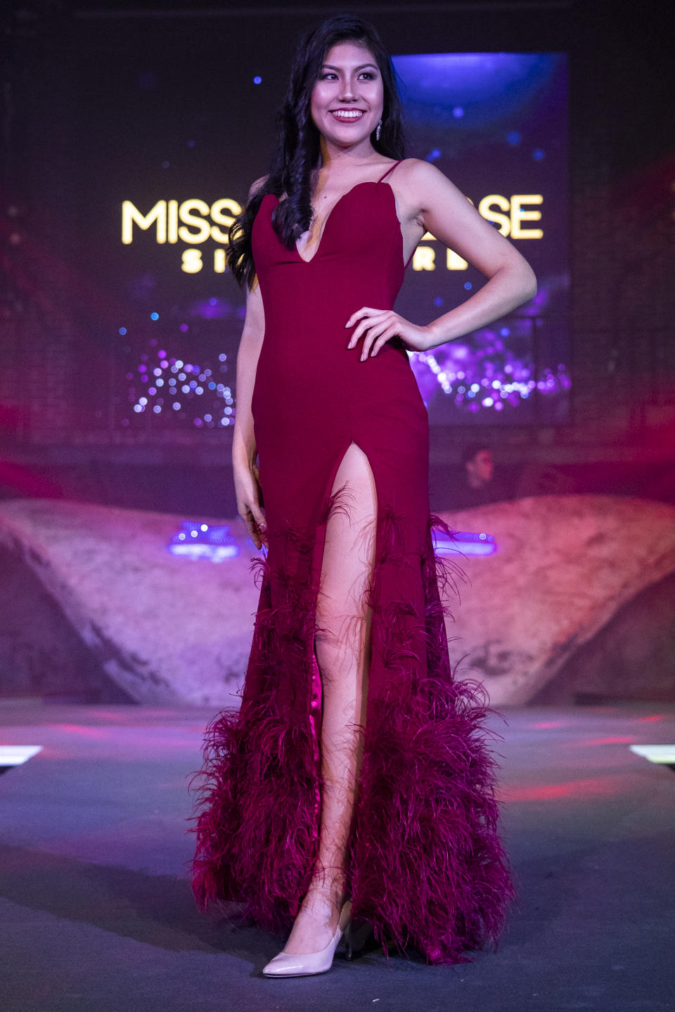 Lynette Chua competing in the evening gown segment during the 2019 Miss Universe Singapore at Zouk.