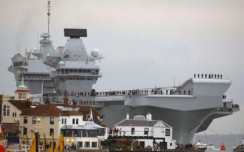 HMS Queen Elizabeth squeezes into Portsmouth Harbour, where - at its narrowest point - there was less than 66ft clearance on each side - Credit: Steve Parsons/PA