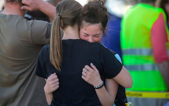 Students comfort each other after the shooting, which injured three people - John Roark/The Idaho Post-Register