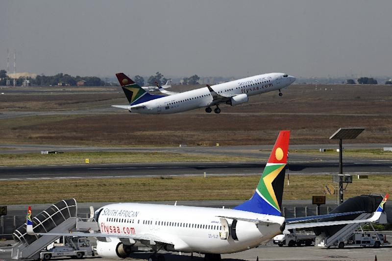 South African Airways wants to lease out surplus pilots and cabin crew to other airlines to cut costs (AFP Photo/GIANLUIGI GUERCIA)