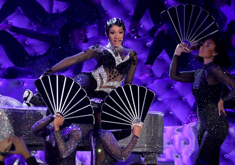 Spectacle: Cardi's performance featured backing dancers and a giant piano (Matt Sayles/Invision/AP)