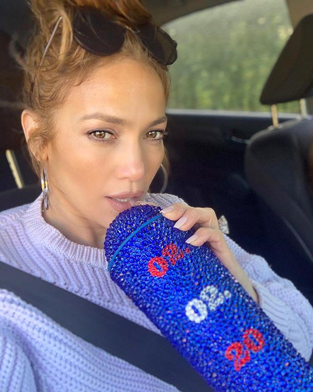 """<p>Hydration is so crucial for the singer that it's a whole category in her ultra-clean diet. (J.Lo's diet categories include protein, vegetables, fats, carbohydrates, and water, according to her trainer and life coach, Dodd Romero.) """"She drinks a minimum of seven glasses a day,"""" he told <em><a href=""""https://www.usmagazine.com/celebrity-body/news/jennifer-lopezs-trainer-reveals-her-leg-abs-workout-diet-menu/"""" target=""""_blank"""">US Weekly</a></em>.</p><p>It's a safe bet her famous bling cup she takes everywhere is filled with H2O. Jenny has also long-avoided alcohol and caffeine. """"I haven't had caffeine in years,"""" she told <a href=""""https://hollywoodlife.com/2016/01/06/jennifer-lopez-diet-weight-loss-fitness-routine-exercise/"""" target=""""_blank""""><em>Hollywood Life</em></a>. </p><p><a href=""""https://www.instagram.com/p/B7hONHjpNqC/?utm_source=ig_embed"""">See the original post on Instagram</a></p>"""