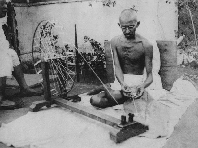 """The spinning wheel, or charkha, symbolised all that Gandhi stood for - swadeshi, sustainability, self-sufficiency, inclusiveness and independence. Gandhi started making his thread using the spinning wheel or charkha when he was held prisoner at Pune's Yeravda prison. What started as a means of personal comfort soon became a clarion call for going swadeshi, as Gandhi urged Indians to spin their cloth instead of relying on British material. He believed that the need of the hour was the revival of the cottage industries, which would help alleviate poverty. According to Gandhi, the spinning wheel is a """"Symbol of the nation's prosperity and, therefore, freedom. It is a symbol not of commercial war but commercial peace."""" The charkha became synonymous with the Indian Independence movement and was also included in the previous version of the Indian flag."""