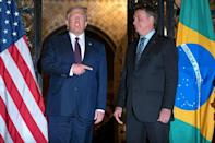 Jair Bolsonaro (right), sometimes known as the 'Tropical Trump', met Donald Trump in Palm Beach, Florida in March 2020