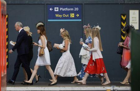 Racegoers travel to Royal Ascot from Waterloo Station in London, Britain June 21, 2018. REUTERS/Kevin Coombs