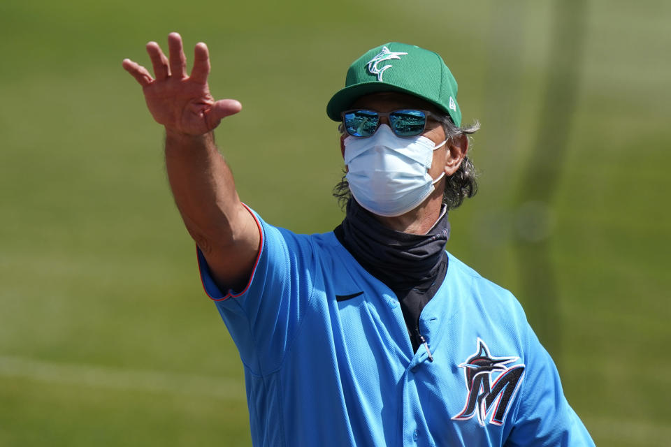 Miami Marlins manager Don Mattingly waves to the stands before a spring training baseball game against the New York Mets, Wednesday, March 17, 2021, in Jupiter, Fla. The former New York Yankees' American League batting champion knows his place now is in the dugout. As manager of the Miami Marlins, Don Mattingly finds it easy to resist any temptation to step to the plate and show his pitchers who he is — or was. (AP Photo/Lynne Sladky)