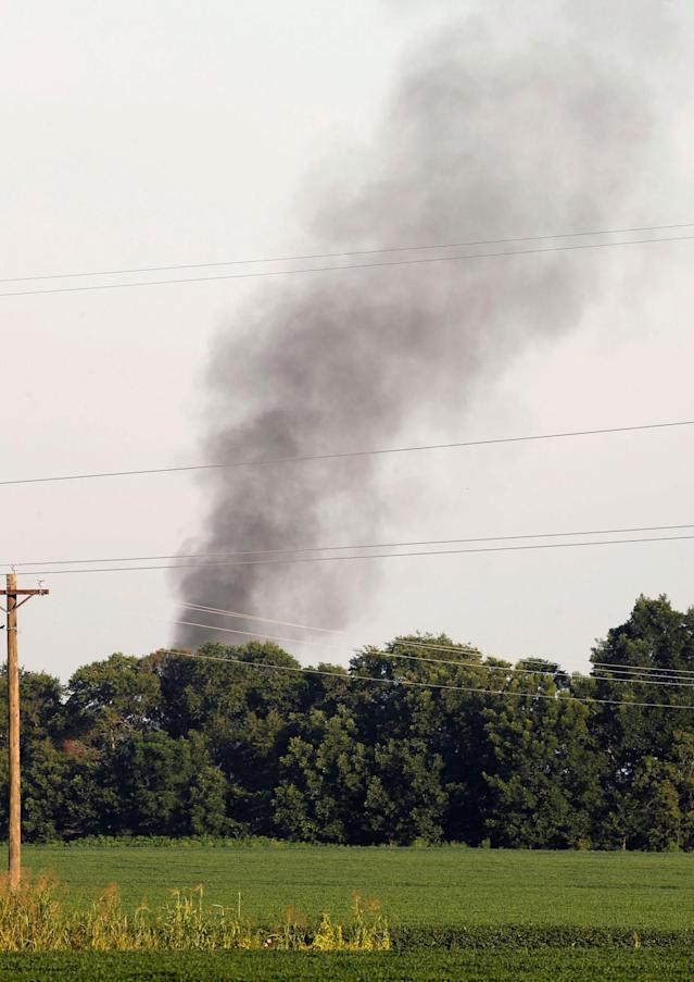 <p>Smoke rises in the air after a military transport plane crashed into a field near Itta Bena, Miss., on the western edge of Leflore County, as seen from U.S. Highway 82, Monday, July 10, 2017. Several were killed in the crash. (Photo: Andy Lo/AP) </p>