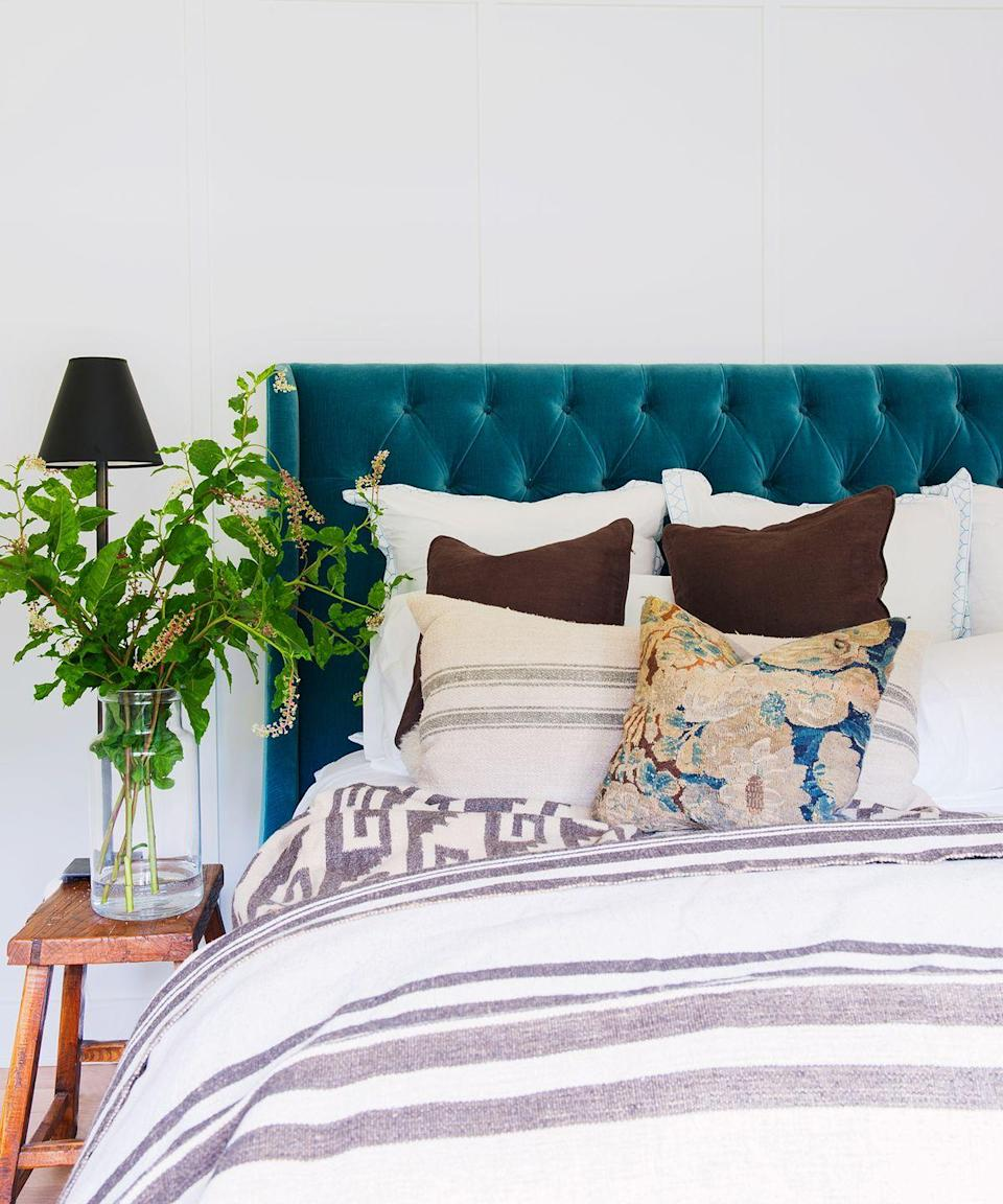 "<p>To design the <a href=""https://www.goodhousekeeping.com/home/decorating-ideas/g770/decor-ideas-master-bedroom/"" rel=""nofollow noopener"" target=""_blank"" data-ylk=""slk:bedroom retreat of your dreams"" class=""link rapid-noclick-resp"">bedroom retreat of your dreams</a>, introduce strategic lighting, more greenery, and <a href=""https://www.goodhousekeeping.com/home-products/g27672604/best-bedding/"" rel=""nofollow noopener"" target=""_blank"" data-ylk=""slk:upgraded bedding"" class=""link rapid-noclick-resp"">upgraded bedding</a>. Not sure where to start? An upholstered headboard can set the foundation for your design scheme.</p>"
