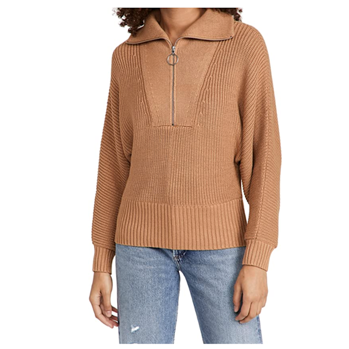 """As one <a href=""""https://www.glamour.com/gallery/best-half-zip-sweaters?mbid=synd_yahoo_rss"""" rel=""""nofollow noopener"""" target=""""_blank"""" data-ylk=""""slk:Glamour"""" class=""""link rapid-noclick-resp""""><em>Glamour</em></a> writer put it, half-zip pullovers check all boxes for comfort and style. Think of this neutral version as an upgrade to a classic sweatshirt—but with a statement zipper, an oversized collar, ribbed sleeves, and other details that feel so <em>now</em>. $275, Amazon. <a href=""""https://www.amazon.com/STAUD-Womens-Kirby-Sweater-Medium/dp/B09DHFQKDW"""" rel=""""nofollow noopener"""" target=""""_blank"""" data-ylk=""""slk:Get it now!"""" class=""""link rapid-noclick-resp"""">Get it now!</a>"""