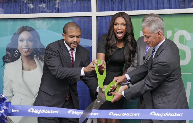 "CORRECTS NAME OF CENTER TO THE WEIGHT WATCHERS JENNIFER HUDSON CENTER - Chicago Alderman Will Burns, left, Grammy and Oscar-winning singer and actress Jennifer Hudson, Dave Burwick, President, Weight Watchers North America, and Chicago Mayor Rham Emanuel take part in a ribbon cutting at the opening of ""The Weight Watchers Jennifer Hudson Center,""  Tuesday, Sept. 27, 2011, in Chicago. Hudson has lost 80 pounds and is a spokeswoman for the company. (AP Photo/M. Spencer Green)"