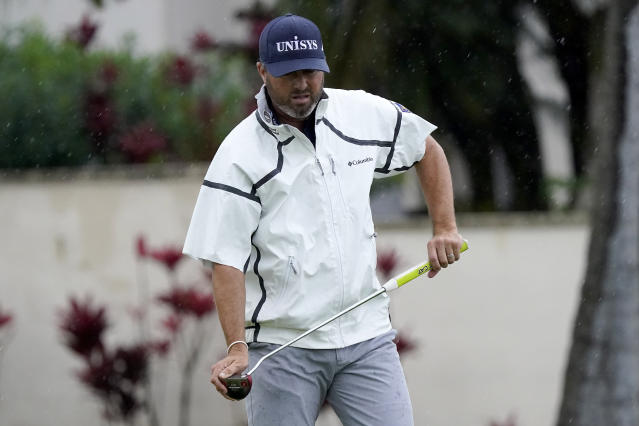 Ryan Palmer misses his birdie putt on the 16th green during the final round of the Sony Open PGA Tour golf event, Sunday, Jan. 12, 2020, at Waialae Country Club in Honolulu. (AP Photo/Matt York)