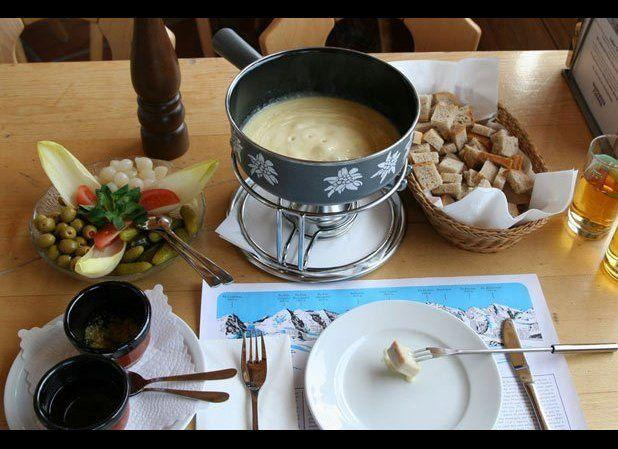 "From the French verb ""to melt,"" fondue is the ultimate après-ski meal. Perfect for a romantic meal for two or for a group, fondue requires long-stemmed forks to dip accoutrements like bread cubes into gooey, melted cheese. Some of Switzerland's top pots can be found at Au Vieux Carouge. <a href=""http://www.thedailymeal.com/150-foods-worth-traveling?utm_source=huffington%2Bpost&utm_medium=partner&utm_campaign=regionalburgs"" target=""_hplink""><strong>Click here to see All 150 Foods Worth Traveling For</strong></a> <em>Credit: wiki/MagnusManske</em>"