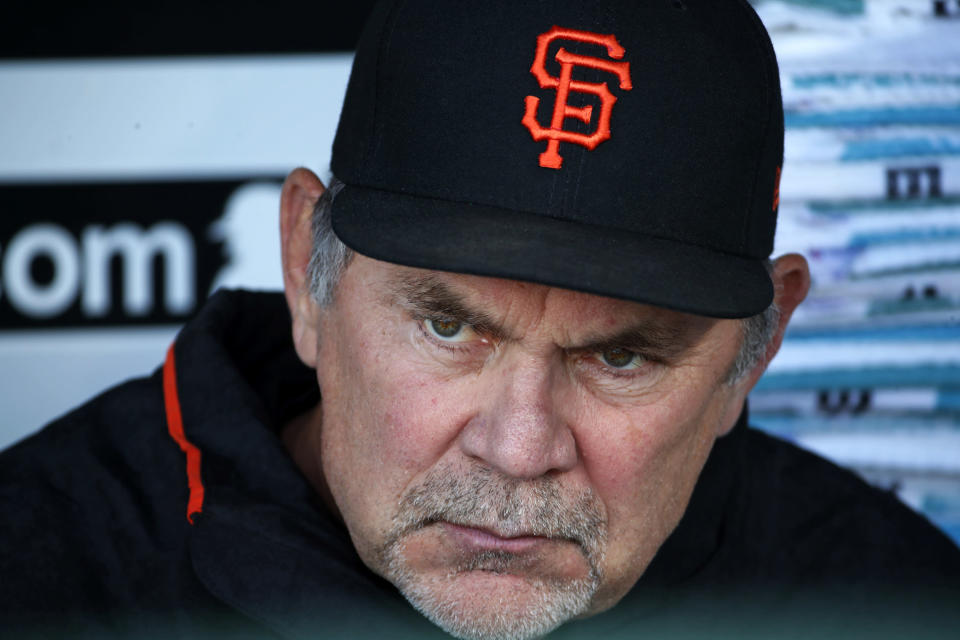 FILE - In this May 11, 2018 file photo, San Francisco Giants manager Bruce Bochy sits in the dugout before a baseball game against the Pittsburgh Pirates in Pittsburgh. The Giants have had a quiet offseason, aside of course from acquiring new president of baseball operations Farhan Zaidi from the rival and six-time defending division champion Dodgers and challenging him with getting this proud franchise back into contention. (AP Photo/Gene J. Puskar, File)
