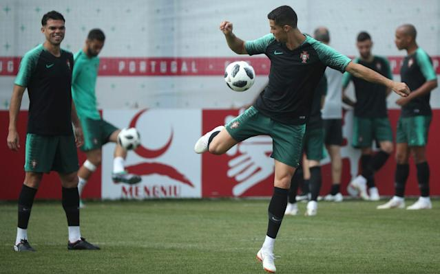 ​Spain vs Morocco, live updates 7:04PM 4 min Iran 0 Portugal 0 Early shot from Ronaldo. He bustles his way into the box and pings a shot off from about 12 yards out that Beiranvand does well to hold onto. 7:02PM 2 min Iran 0 Portugal 0 Guerreiro is chopped to the ground by Omid in what is a real 'welcome to the game challenge'. Iran clear the resulting free-kick. Huge noise from the Iran supporters. 7:00PM 1 min Iran 0 Portugal 0 We're under way in Saransk. Iran will qualify with a win; Portugal need just a point to go through, and to better Spain's result to top the group. The group winners play Russia in the last 16; the runners up will play Uruguay. A reminder of the teams for this one. Iran (4-3-2-1): Beiranvand; Ramin, Hosseini, Pouraliganji, Safi; Jahanbakhsh, Ezatolahi, Omid; Mehdi, Amiri; Sardar Portugal (4-4-2): Patricio; Cedric, Pepe, Fonte, Guerreiro; William Carvalho, Adrien, Joao Mario, Quaresma; Andre Silva, Ronaldo. Credit: Getty Images 6:57PM The teams are out It's a sell-out crowd at the Mordovia Arena, as the two sides belt out their respective national anthems. Iran look to have by far the majority of the fans inside the stadium. 6:52PM Those Portugal changes in full Now pay attention 007, because this is a little Silva-heavy. Andre Silva, Adrien Silva and Ricardo Quaresma come in, while Goncalo Guedes, Bernardo Silva and Joao Moutinho drop to the bench. Iran replace Karim Ansarifard with Alireza Jahanbakhsh. Bernardo Silva is on the Portugal bench Credit: Getty Images 6:43PM No Bernardo Silva is a suprise Ricardo Quaresma replaces him. Portugal remember are almost certainly out if they lose here. 6:37PM Prediction Who's going to win tonight? Let our clever machine tell you based on what you think the most important factors will be. World Cup 2018 Simulator Single Game 6:26PM Down to the wire There is the possibility that tonight could end in sensational fashion with the drawing of lots. That is if Portugal and Spain both win or draw with the exact same scoreline and end up with the same number of bookings (Spain as it stands have one fewer booking). The draw would take place at the Luzhniki Stadium in Moscow at 9pm BST this evening. It couldn't happen, could it? Spain take on Morocco in tonight's other game. 6:11PM Team news Iran (4-3-2-1): Beiranvand; Ramin, Hosseini, Pouraliganji, Safi; Jahanbakhsh, Ezatolahi, Omid; Mehdi, Amiri; Sardar Portugal (4-4-2): Patricio; Cedric, Pepe, Fonte, Guerreiro; William Carvalho, Adrien, João Mario, Quaresma; Andre Silva, Ronaldo. Three changes from the team that scraped to a 1-0 win over Morocco. #IRNPOR // The teams are in! pic.twitter.com/tmsdH1iunk— FIFA World Cup �� (@FIFAWorldCup) June 25, 2018 5:52PM What will Portugal's tactics be tonight? Our expert JJ Bull has taken a close eye at Fernando Santos's team, and brings you this video... 5:33PM How Group C looks going into the match Portugal need a draw to qualify for the last 16. 5:30PM The Ronaldo roadshow rolls on The final group games continue tonight, with Portugal in action against Iran. A draw will be enough for Portugal to qualify for the group stages, while Iran will qualify with a win. The picture is complicated by what Spain do against Morocco in the group's other match tonight, but essentially Portugal need to better Spain's result to top the group. There's a big incentive in topping the group because the winners will face Uruguay rather than Russia in the last 16. Earlier today Uruguay were very effective in brutally dismissing the hosts Russia 3-0 in Samara. Back to Group B and the matter in hand ... Portugal will be hoping not only to win but to produce a performance more convincing than the turgid fare they produced in Wednesday's 1-0 win over Morocco. Manager Fernando Santos is known for his pragmatic tactics, but even he accepted Portugal were disappointing in the way they sat back after taking an early lead. Cristiano Ronaldo was of course the man who scored their goal to add to his hat-trick against Spain on match day one. Ronaldo has scored all of Portugal's goals at this World Cup, and he will be desperate to get a couple tonight to leapfrog Harry Kane in the Golden Boot race. Ronaldo will also want to make a point to Iran manager Carlos Queiroz after the pair fell out at the 2010 World Cup when Queiroz was Portugal manager. Cristiano Ronaldo and Iran manager Carlos Queiroz do not see eye to eye Queiroz, for his part, will be focused on stopping Ronaldo tonight as his team look to build on their impressive - if ultra-defensive - performance against Spain last time out. Iran ended up losing 1-0 but were very close to nicking an unexpected point. Given their need for a win tonight, Iran will at some point need to come out and attack. Don't expect that to happen until the latter stages though, especially if Portugal fail to score early. Portugal should get this done, but they're going to have to work for it.