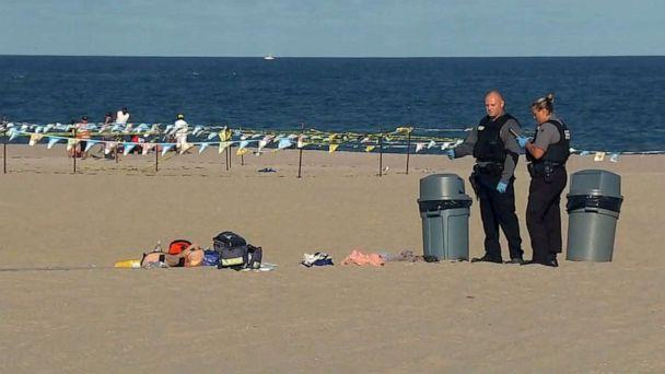 PHOTO: Authorities stand near some belongings left on the beach after a stabbing at Point Pleasant Beach in New Jersey on Sept. 7, 2020. (WABC)