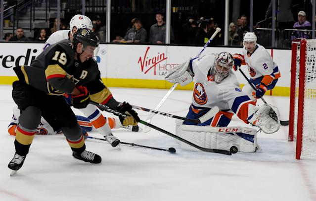 Vegas Golden Knights right wing Reilly Smith (19) shoots as New York Islanders goalie Semyon Varlamov defends during the second period of an NHL hockey game Saturday, Feb. 15, 2020, in Las Vegas. (AP Photo/Isaac Brekken)