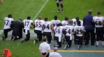 Sep 24, 2017; London, United Kingdom; Baltimore Ravens players kneel during the playing of the Untied States national anthem before a NFL International Series game against the Jacksonville Jaguars at Wembley Stadium. Mandatory Credit: Kirby Lee-USA TODAY Sports