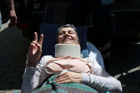 Pro-Kurdish Peoples' Democratic Party (HDP) lawmaker Leyla Guven, who ends her hunger strike after a call from jailed militant leader Abdullah Ocalan, flashes a V-victory sign as she leaves her home to go to hospital in Diyarbakir, Turkey, May 26, 2019. REUTERS/Sertac Kayar