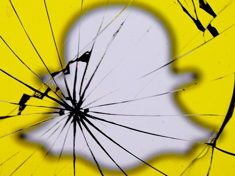 A Snapchat logo is seen through broken glass in this illustration picture, May 11, 2017: REUTERS/Dado Ruvic