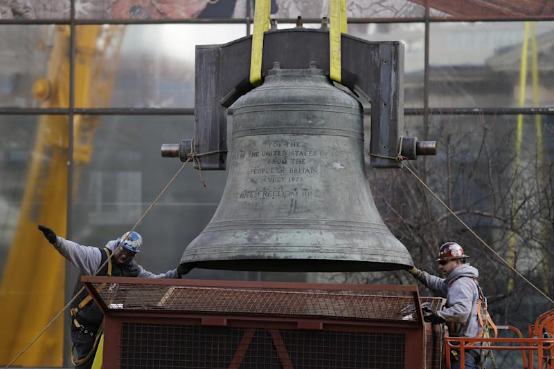 Workmen guide the Bicentennial Bell before lifts it to a shipping container, Thursday, Jan. 31, 2013, in Philadelphia. The bell made in the same British foundry as its twin of the iconic Liberty Bell was a 1976 Bicentennial gift from from England and was presented by Queen Elizabeth II to the city.  The bell tower and its accompanying building, constructed for the 1976 Bicentennial, are being demolished to make way for a Revolutionary War museum.  (AP Photo/Matt Rourke)