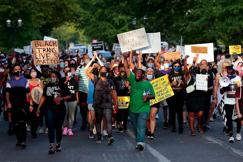 Hundreds of protesters marched down Waterman Boulevard heading to St Louis Mayor Lyda Krewson's home on Sunday (AP)