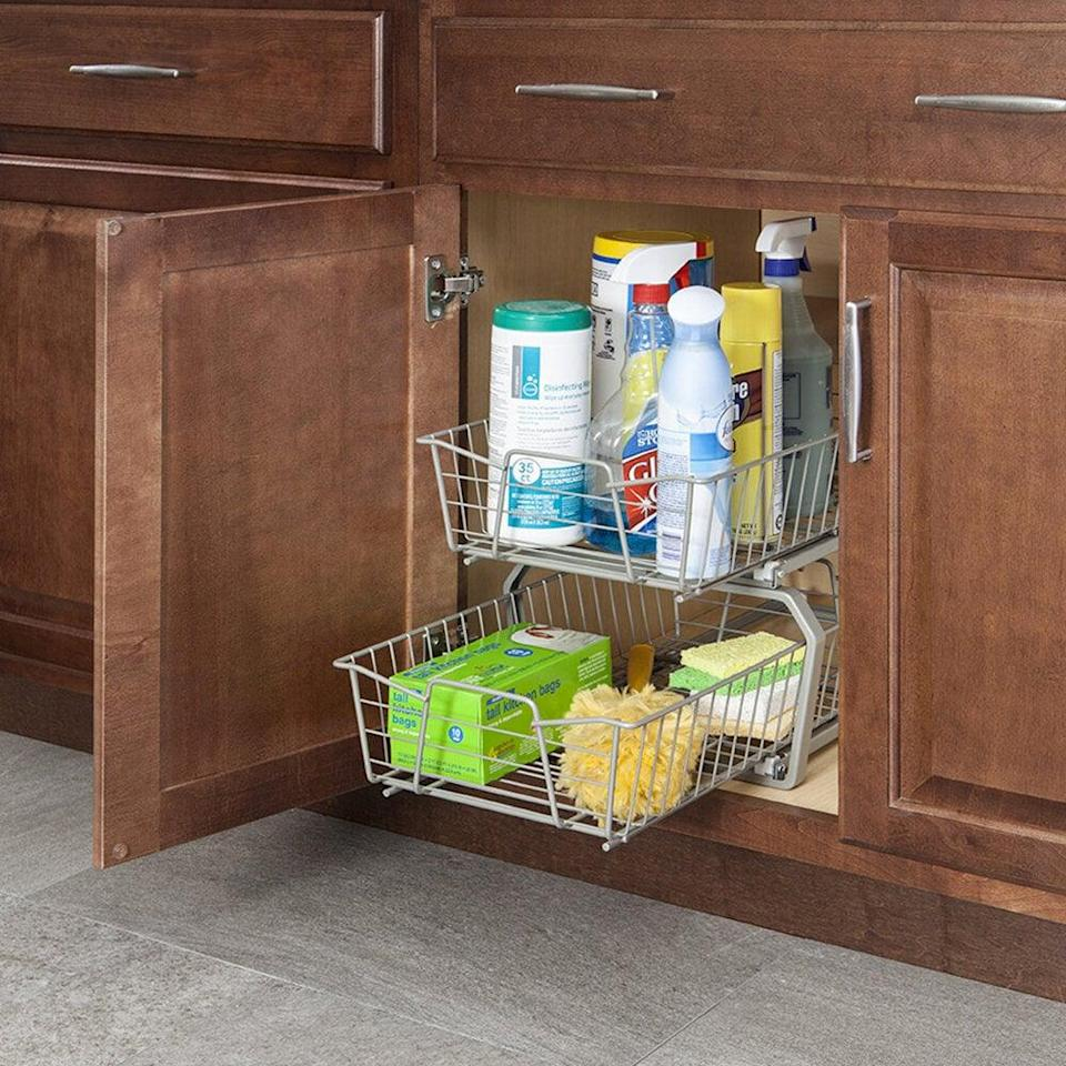 <p>Get this <span>2 Tier Pull Out Drawer</span> ($55) to add more storage to your cabinets. You can store cleaning products, snacks, reusable food storage containers and more.</p>