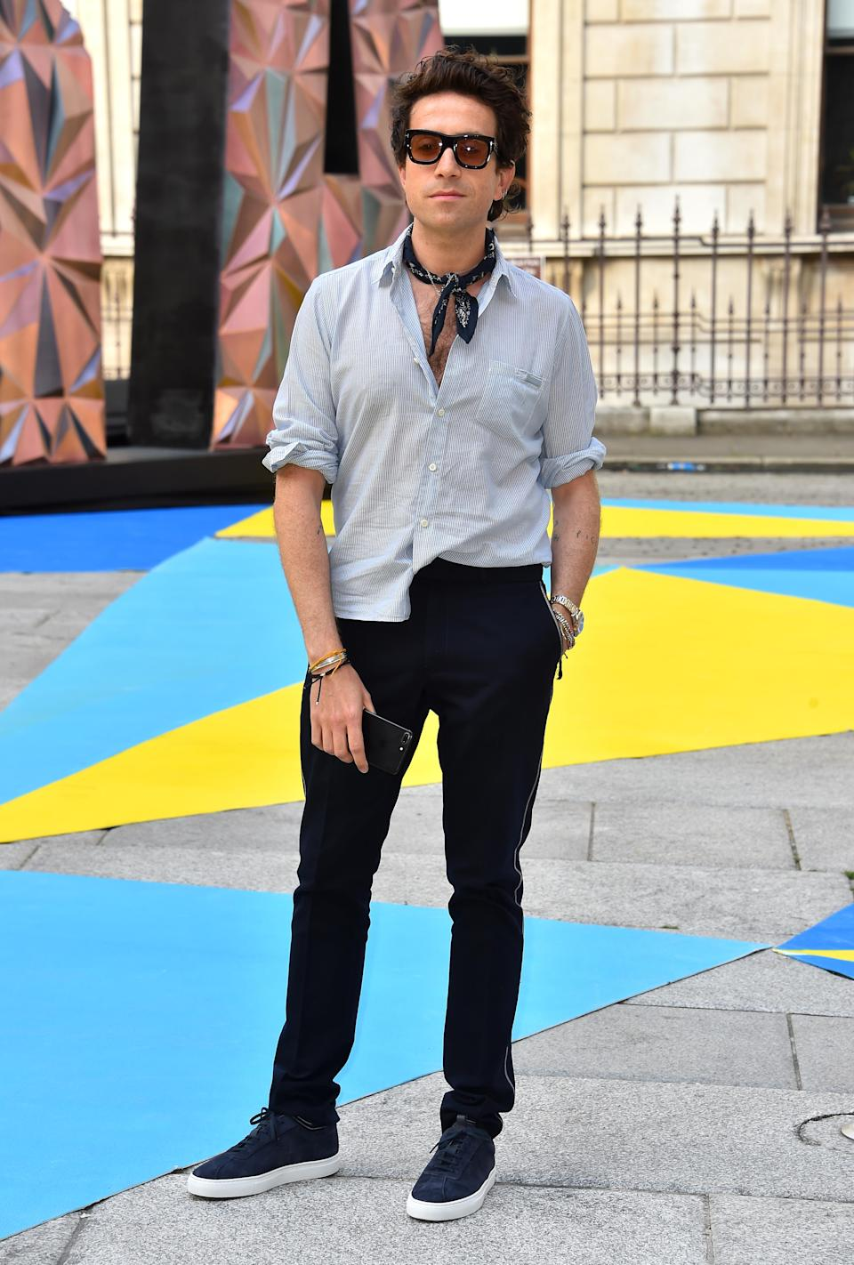 <p>Nick Grimshaw gave us serious summer vibes in a half-stucked shirt and neck-tie at the Royal Academy of Arts summer party. <em>[Photo: Getty]</em> </p>