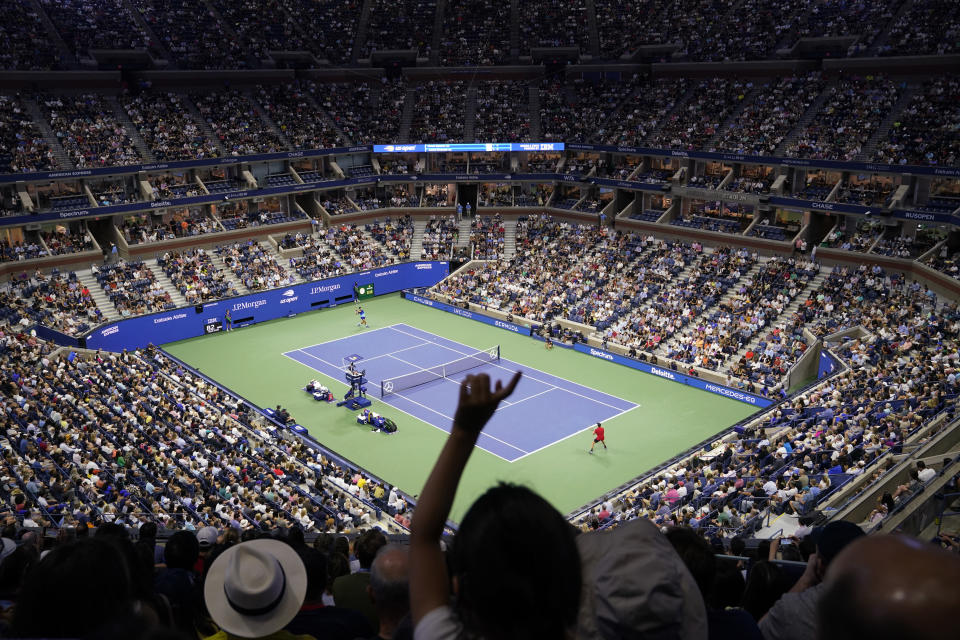Novak Djokovic, of Serbia, left, returns against Jenson Brooksby, of the United States, during the fourth round of the U.S. Open tennis championships in Arthur Ashe Stadium, Monday, Sept. 6, 2021, in New York. (AP Photo/John Minchillo)