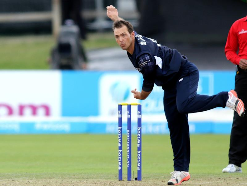 Scotland's Con De Lange bowls during the ICC World Twenty20 Qualifer between Scotland and Hong Kong at Malahide cricket club, north of Dublin on July 25, 2015. AFP PHOTO / PAUL FAITH (Photo credit should read PAUL FAITH/AFP/Getty Images)