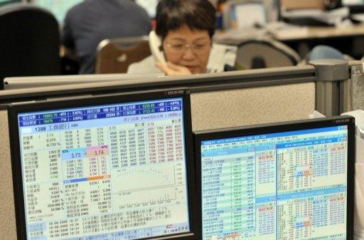A local investor trades shares at a securities firm in Hong Kong