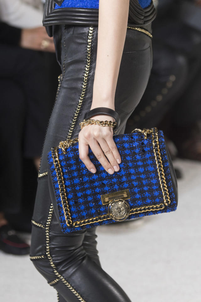 <p><i>Blue and black tweed gold chain handbag from the SS18 Balmain collection. (Photo: ImaxTree) </i></p>