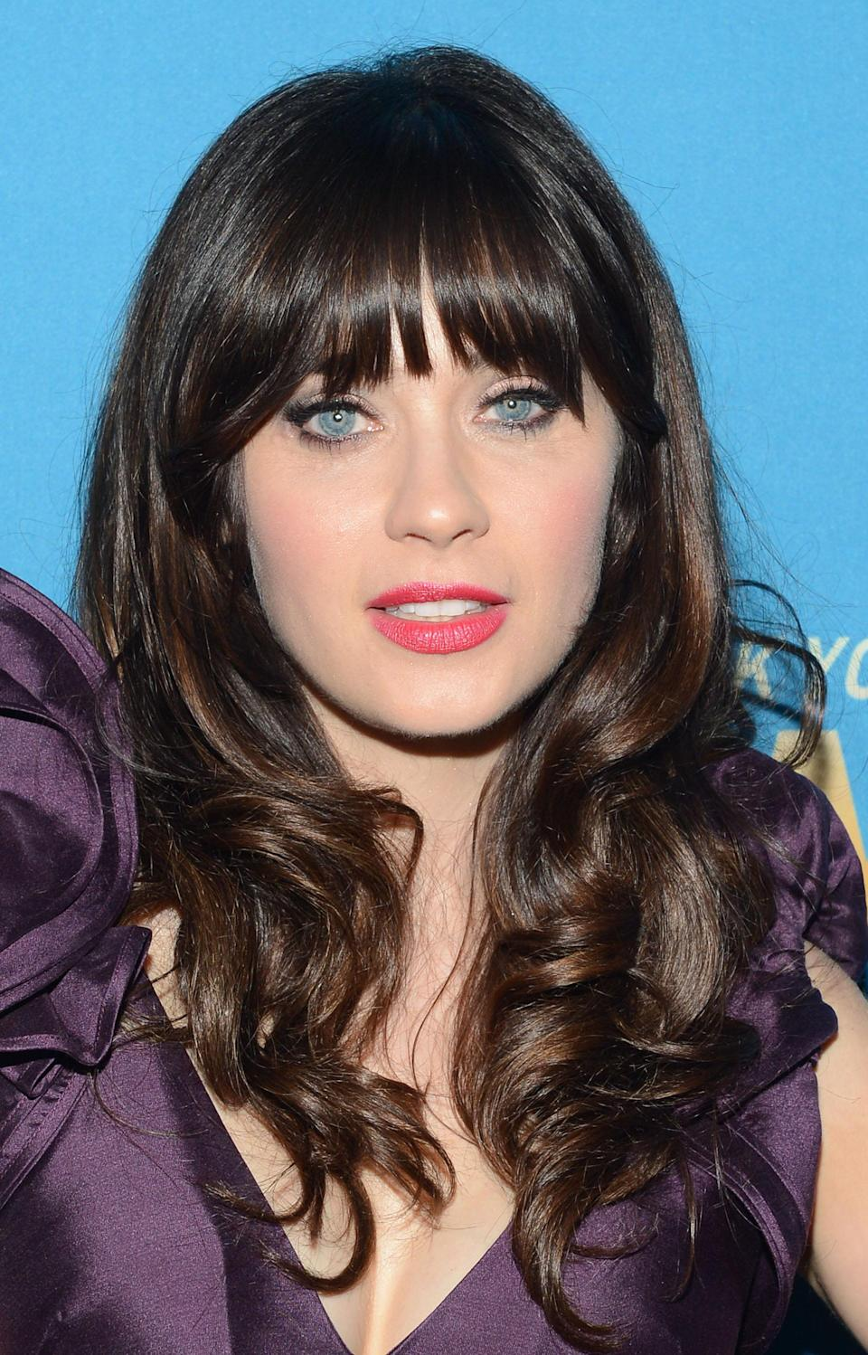 "<b>Zooey Deschanel:</b> ""I'm terribly sad to hear about what happened in Aurora, Co. last night, my thoughts and prayers are with the victims of this tragedy."" (Photo by Mark Davis/Getty Images)"
