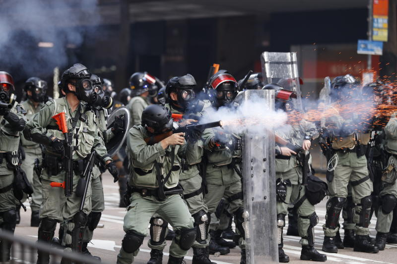 Police fire tear gas to disperse anti-government protesters in Hong Kong, Tuesday, Oct. 1, 2019. (Photo: Vincent Thian/AP)