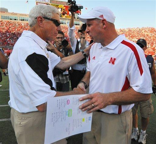 Nebraska's Bo Pelini, right, and Southern Miss's Ellis Johnson shake hands after their NCAA college football game, Saturday, Sept 1, 2012, in Lincoln, Neb. (AP Photo/Dave Weaver)