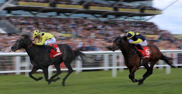 Defoe (left) ridden by Andrea Atzeni on the way to winning the Geoffrey Freer Stakes at Newbury last season