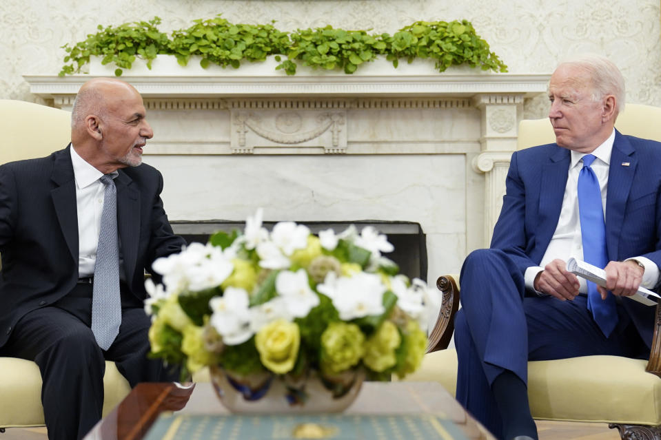 President Joe Biden, right, meets with Afghan President Ashraf Ghani, left, in the Oval Office of the White House in Washington, Friday, June 25, 2021. (AP Photo/Susan Walsh)