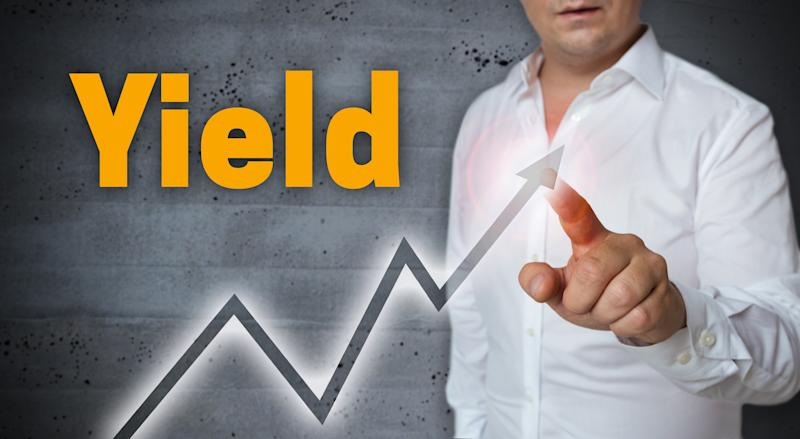 Man pointing to an line trending up with the word Yield printed above the line