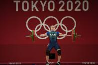 Polina Guryeva of Turkmekistan competes in the women's 59kg weightlifting event, at the 2020 Summer Olympics, Tuesday, July 27, 2021, in Tokyo, Japan. (AP Photo/Luca Bruno)