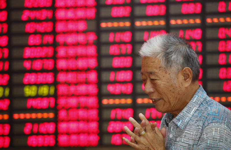 An investor looks at the stock price monitor at a private securities company Monday Aug. 19, 2013 in Shanghai, China. Asian stock markets were little changed Monday as traders weighed the consequences of an anticipated phasing out of the U.S. central bank's unprecedented stimulus program. (AP Photo)