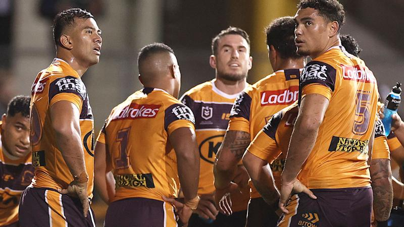 Pictured here, Brisbane Broncos players look on solemnly after their big loss to the Wests Tigers.