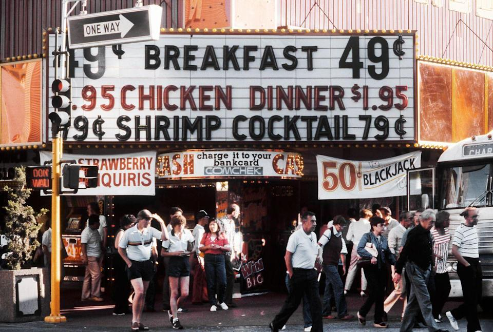 <p>A marquee lists the low prices available for breakfast, chicken, or a shrimp cocktail. Less than two dollars for a chicken dinner? Yes, please! </p>