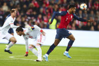 Spain's Sergio Ramos, left, fights for the ball against Norway's Joshua King, right, during the UEFA Euro 2020 qualifying Group F soccer match between Norway and Spain at Ullevaal Stadium in Oslo, Norway on Saturday, Oct. 12, 2019. (Tore Meek/NTB scanpix via AP)