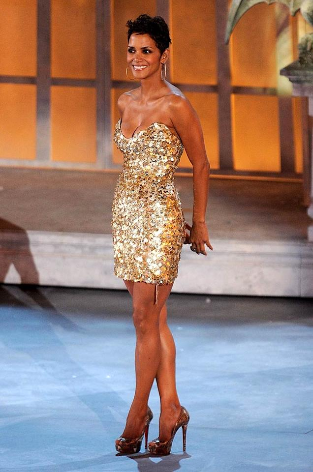 """Speaking of sparkles ... Halle Berry -- who was undoubtedly the best-dressed beauty in attendance at Spike TV's annual Scream soiree -- looked breathtaking in her gold pailette-covered Reem Acra micro mini and matching metallic peep-toes. Michael Caulfield/<a href=""""http://www.gettyimages.com/"""" target=""""new"""">GettyImages.com</a> - October 16, 2010"""