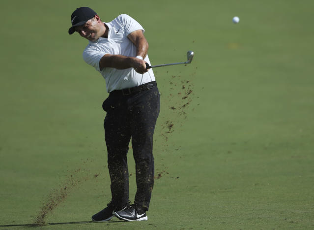 Italy's Francesco Molinari plays a shot on the 1st hole during the first round of the DP World Tour Championship golf tournament in Dubai, United Arab Emirates, Thursday, Nov. 15, 2018. (AP Photo/Kamran Jebreili)
