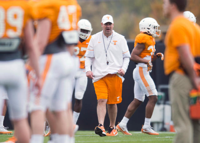 FILE - In this March 27, 2018, file photo, Tennessee head coach Jeremy Pruitt walks on the field during an NCAA college football practice in Knoxville, Tenn. Pruitt has brought plenty of change to Knoxville. Even the format of Tennessee's annual spring football game is different. (Caitie McMekin/Knoxville News Sentinel via AP, File)